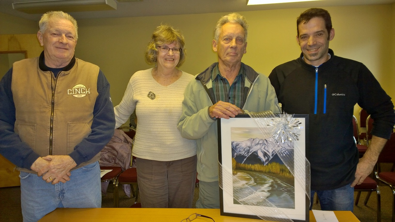 Area C Director Russell Mack (far left) and Village of Pemberton Mayor Mike Richman (far right) present Jan and Hugh Naylor with a Karen Love painting at the November 23 signing ceremony of a Right of Way over their property, securing access to trails and the river for generations of future users